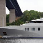 Profile of Superyacht Skat in Kiel Canal passing under a bridge