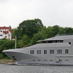 Profile of Superyacht Skat in Kiel Canal, with VIlla Hoheneck